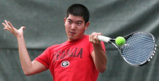 Daniel Yun, 19, a sophomore Health Promotions major at the University of Georgia from Duluth, Ga., plays tennis on the UGA intramural courts on Monday, Sept. 14, 2009 in Athens, Ga. The tennis courts are open in the evenings for student recreation.