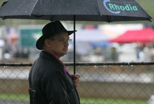 Steve McClung, 57, a plant manager for Rodeo Inc., from Spartan, S.C., sticks out the rain at Road Atlanta in Braselton, Ga., to see if the Petit Le Mans race will start again after being red-flagged around the 6-hour mark on Saturday, Sept. 26, 2009. The 10-hour endurance race was finished under red. (Photo/ Jackie Reedy, jackiereedy@gmail.com)