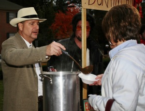 Doug Aldrian, 46, from Atlanta, Ga., serves chili to Glenda Brandt, 51, a secretary for Dawson County High School from Dawsonville, Ga., at Gamma Phi Beta's 16th Annual Chili Cook-off on Sunday, Oct. 25, 2009 in Athens, Ga. Hunkahunka Burnin' Chili won the cook-off's Most Creative Table Décor Award.